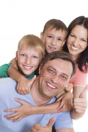 Photo pour Belle famille de quatre personnes sur fond clair - image libre de droit