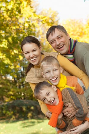 Photo for Portrait of a nice family on the nature - Royalty Free Image