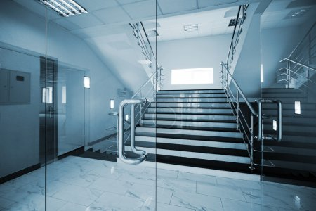 Photo for Glass doors with a kind on a marble staircase - Royalty Free Image