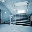 Glass doors with a kind on a marble staircase...