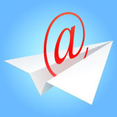 E-mail symbol flying on paper plane against the blue sky