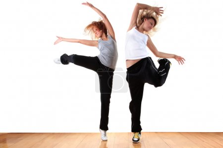 Woman modern sport ballet dancers in ballroom