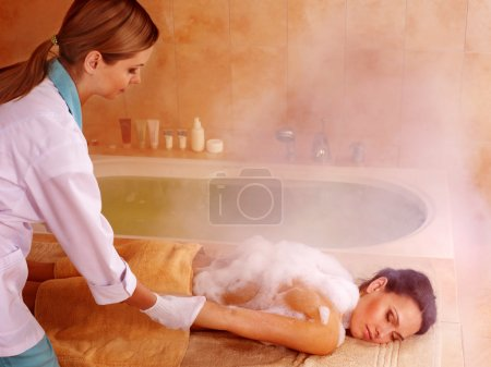 Woman in hammam or turkish bath