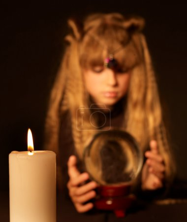 Child holding crystal ball.