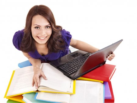 Girl with stack color book and laptop.