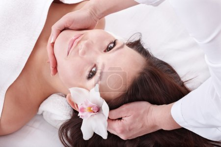 Photo for Beautiful young woman in spa. Facial massage. - Royalty Free Image
