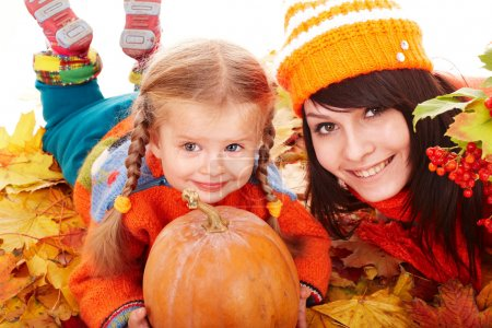 Photo for Happy family with pumpkin on autumn leaves. Outdoor. - Royalty Free Image