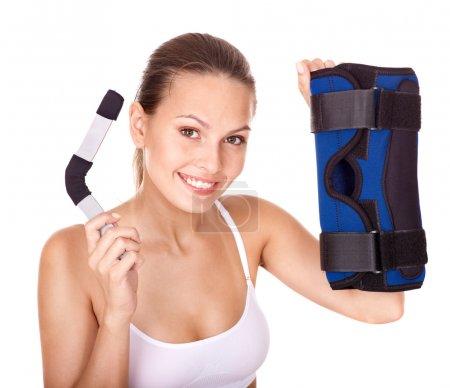 Woman holding hinged knee braces.