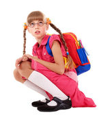 Scared sitting schoolchild in eyeglasses.
