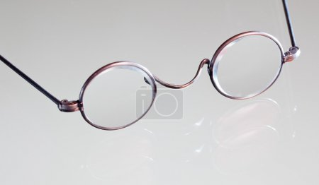 Antique reading glasses isolated