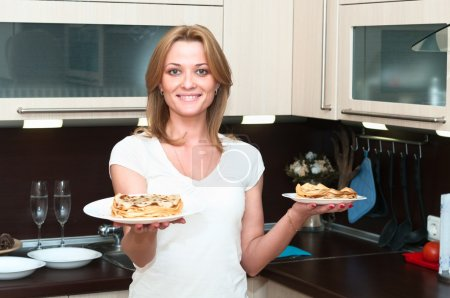 Beautiful happy smiling woman in kitchen interior.