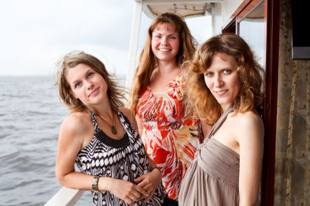 Three beautiful young women a Caucasians standing ...
