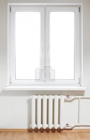 White plastic double door window with radiator under it