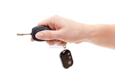 Hand with car keys.