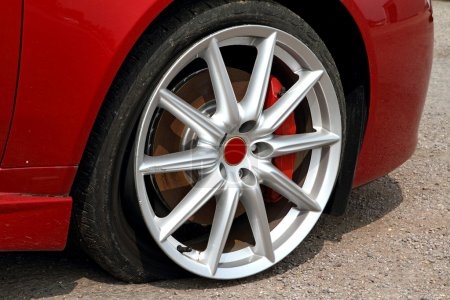 Photo for Deflated tyre damage to car wheel - Royalty Free Image