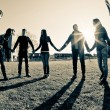 Multiracial Young Holding Hands in a Circle...