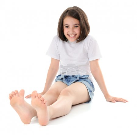 Photo for Smiling girl sitting on a floor. Looking at camera. - Royalty Free Image
