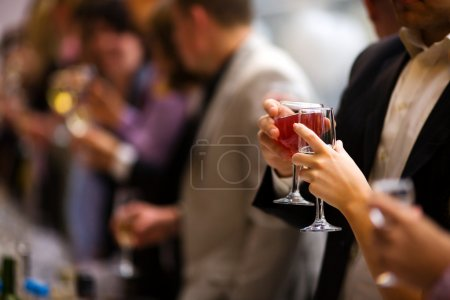 Photo for Holiday Event cheering each other with champagne and wine - Royalty Free Image