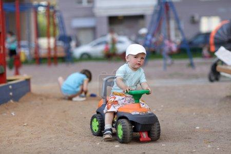 Little boy drives toy ATV