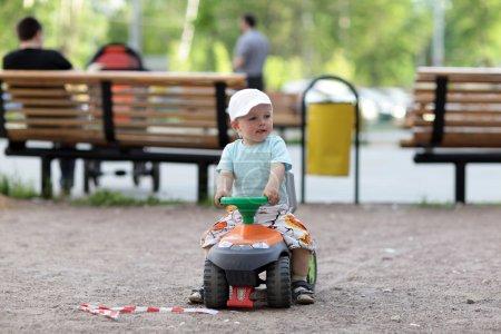 Little boy drives toy Quad Bike