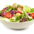Vegetable salad isolated on white...