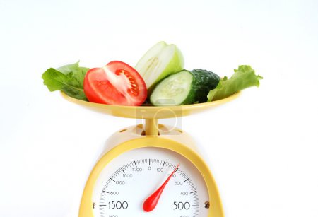 Photo for Sliced fruits and vegetables on kitchen scale - Royalty Free Image