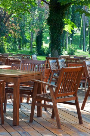 Wooden tables and chairs. Interior of the cafe.