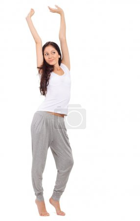 Young beautiful brunette girl stretching after awaking