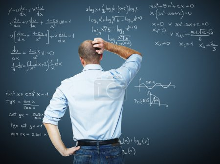 Photo for Young teacher and blackboard with mat write - Royalty Free Image