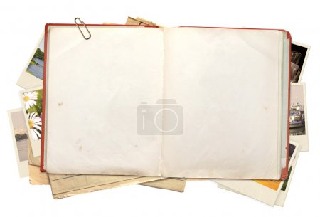Old book and photos. Objects isolated over white...