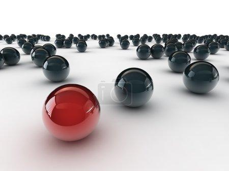 Photo pour Une boule rouge unique, entre autres noir - image libre de droit