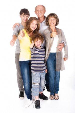 Foto de Familia pulgares posando en estilo, en el interior fondo blanco agianst. - Imagen libre de derechos