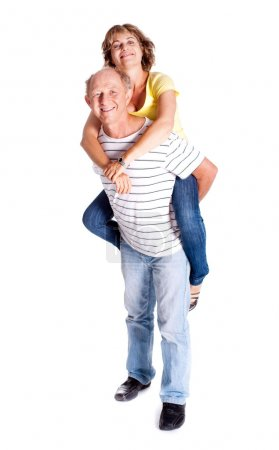 Senior man giving woman piggyback ride