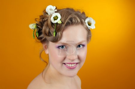 Girl blonde with flowers in her hair