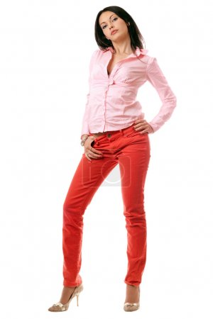 Attractive young brunette in red jeans