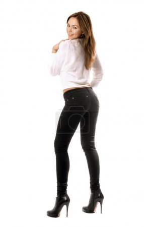 Playful beautiful girl in black tight jeans