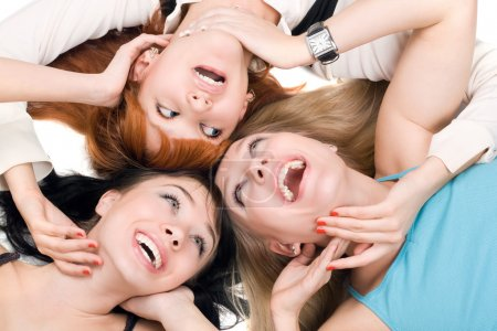 Photo for Portrait of three young smiling women on white background - Royalty Free Image