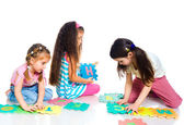 Children are playing letters