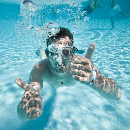 Man floats in pool
