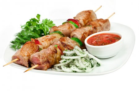 Photo for Tasty grilled meat on a white background, shish kebab - Royalty Free Image
