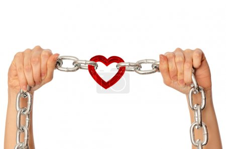 Photo for Woman holding in the hands chain with heart as a symbol of strong love - Royalty Free Image