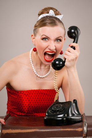 Woman shouting into telephone