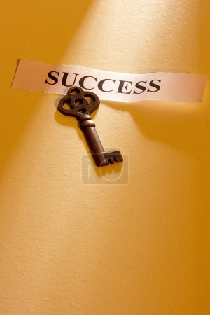 """Photo for A key laying on a piece of paper with the word """"success"""" on it. - Royalty Free Image"""