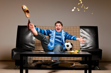 Soccer fan on sofa