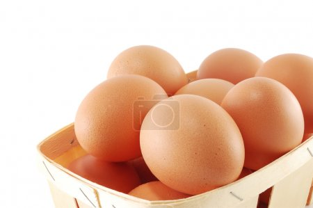 Photo for Eggs in a basket close on a white background - Royalty Free Image