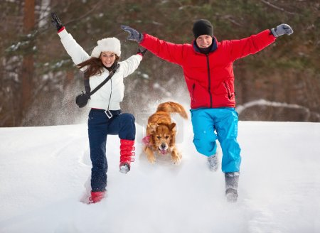 Young couple with dog fun