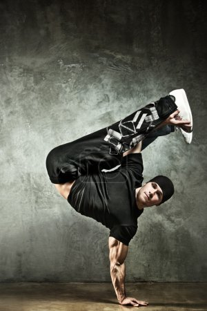 Photo for Young strong man break dance. On wall background. - Royalty Free Image