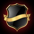 Black shield with a golden frame and a gold ribbon...