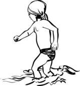 Little boy running through the water on shore beach
