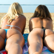 Girls, on tan the beach, in bikini, with backs....